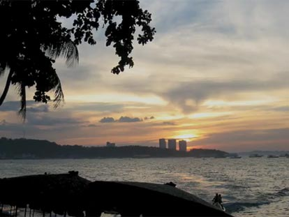 Sunset over Pattaya with jetski before dark